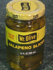 An image of a jar of jalapeño peppers.